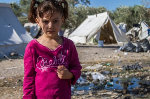 Dana, 5, is one of the many children that make the journey to Greece with their families. They stay in Kara Tepe transit camp, where they wait to eventually be registered and receive their papers to continue their journey into Europe. Photo: Tyler Jump/IRC